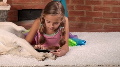 Little girl playing on tablet computer Stock Footage