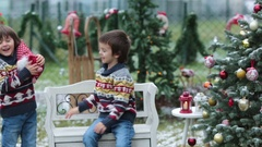 Two adorable brothers having fun outdoors in the garden on Christ Stock Footage