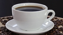 Rotation white cup with a black coffee and coffee beans.  Close up. Stock Footage
