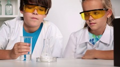 Elementary school chemistry class with experimenting kids Stock Footage