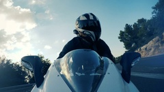 Rider of a sports motorbike Stock Footage