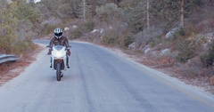 White sports motorbike driving on a road Stock Footage