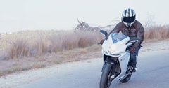 Man on a white sports motorcycle driving Stock Footage