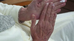 Closeup of old woman's hands applying lotion Stock Footage