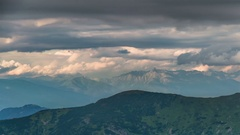 Dramatic evening thunder clouds sky over mountains time lapse Stock Footage