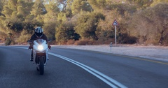 Rider on a sports motorbike from a driving car view Stock Footage