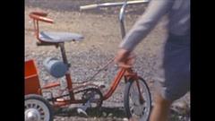 Vintage 16mm film, 1964, France toddler on trike #3 Stock Footage