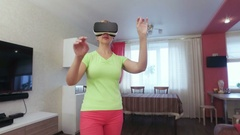 Young beautiful woman with virtual reality in modern interior first experience Stock Footage