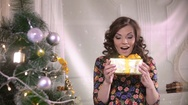 Beauty girl with christmas gift box. Young cute woman happy getting present Stock Footage