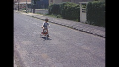 Vintage 16mm film, 1964, France toddler on trike #5 Stock Footage