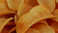 Rotating potato chips , macro view food background Stock Footage