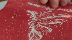 Christmas napkin folding, family dinner Stock Footage