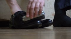 A man cleans leather shoes with brush shoe Stock Footage