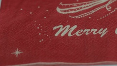 Merry Christmas napkin close up smooth dolly panning shot Stock Footage