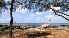 Hammock in a shadow on the sandy coast. Viet Nam Stock Footage