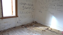 Writings on the wall of deserted house Stock Footage