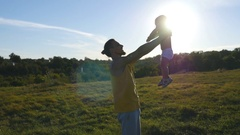 Dad lifting up his child at nature. Happy family spending time together Stock Footage