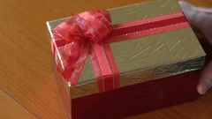 Christmas present in a gift box Stock Footage