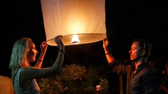 Tourists Releasing Sky Lantern at Loy Krathong Festival in Chiang Mai, Thailand Stock Footage