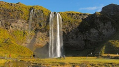 Full shot of icelandic Seljalands River and waterfall Seljalandsfoss in sunny Stock Footage
