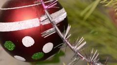 Red Christmas Balls on Christmas Tree. Close up Stock Footage
