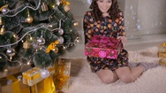 Beauty young woman opening Christmas gift box Stock Footage