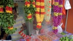 Singapore - 4 November 2016: Indian street vendor make flower necklace Stock Footage