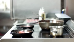 Professional stove stands in the kitchen of the restaurant, the food in the pots Stock Footage