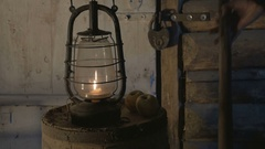 Antique lamp with candle on a wooden table with apples in the evening, the Stock Footage