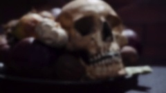 Scary still life with garlic and a skull Stock Footage