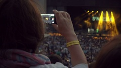 MOSCOW, RUSSIA, JULE 2016: Woman Shooting Music Concert On Mobile Phone Stock Footage