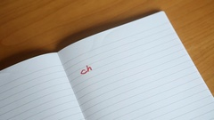 French handwritten letters 'Cher Journal' (Dear Diary) appear on a notepad Stock Footage