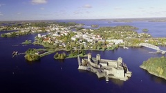 Approaching aerial shot of the town of Savonlinna in Finland Stock Footage