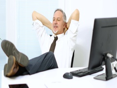 Businessman relaxing in his office Stock Footage