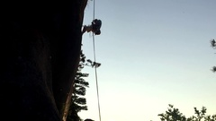 Abseiling off the route at sunset in the Siberian's rocks Stock Footage