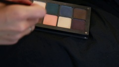 Professional corrector palette with make-up brush, closed-up Stock Footage
