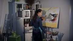 Artist draws a brush on canvas Stock Footage