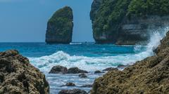 Rock in Tembeling Coastline at Nusa Penida island, Ocean Waves in Front. Bali Stock Photos