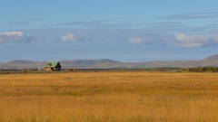 Long shot of calm icelandic landscape with small country house, southern coast Stock Footage