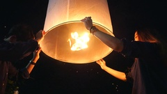 Locals Releasing Floating Lantern at Yee Peng Festival in Chiang Mai, Thailand Stock Footage