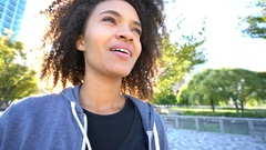 Portrait of woman in sports outfit standing in park Stock Footage