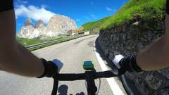 Enjoying a bicycle ride on the beautiful Dolomiti landscape Stock Footage