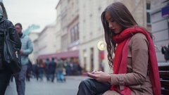 Attractive young brunette in a vivid scarf, and stylish warm coat, with a long Stock Footage
