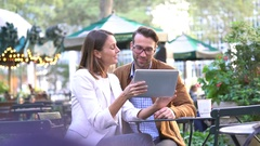 Couple at Bryant park using digital tablet Stock Footage