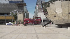Millenium square bristol slow mo sunny red bus Stock Footage