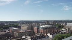 Bristol city centre pan sunny sun flare Stock Footage