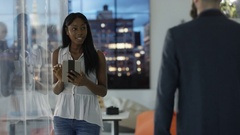 4K Portrait cheerful businesswoman with tablet computer, city view in background Stock Footage
