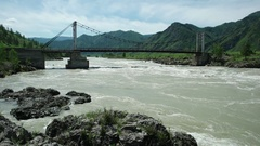 Bridge over Katun river in flood. Altay, Russia. Stock Footage