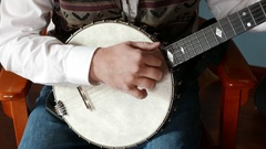 Banjo Style Picking Clawhammer on Vintage Fairbanks Stock Footage