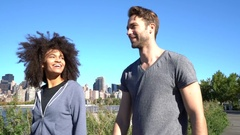 Couple walking on Long island, East river riverbanks Stock Footage